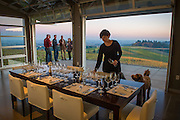 Donna Morris setting the table for a private dinner at Winderlea winery & vineyards, Dundee Hills, Willamette Valley, Oregon