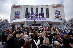 © Licensed to London News Pictures. 14/11/2012. London, UK. Visitors are seen queuing for the 2012 Christmas Ideal Home show at Earl's Court in London today (14/11/12). The show, running from the 14th to the 18th of November features over 600 exhibitors across 6 sections including; Interiors & Furnishings, Food & Drink, Home Improvements & Outdoor Living, Fashion & Beauty, Technology & Gadgets and Gifts & Decorations. Photo credit: Matt Cetti-Roberts/LNP