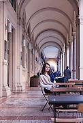 Bologna, Nicola Sherwood, fashion stylist, sitting at La bottega dei Portici, fresh Pasta food lab