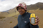 Achupallas - Tuesday, Jan 01 2008: Lorna Brooks shows her GPS displaying an altitude of 4433m at Tres Cruces Pass on the Inca Trail hike from Achupallas to Ingapirca. (Photo by Peter Horrell / http://www.peterhorrell.com)