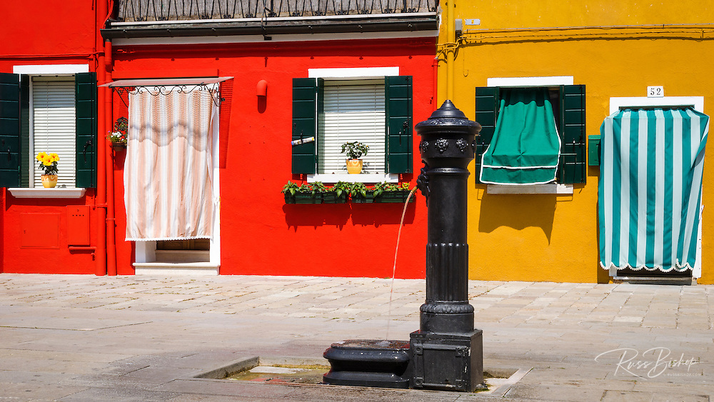 Colorful houses and fountain, Burano, Veneto, Italy
