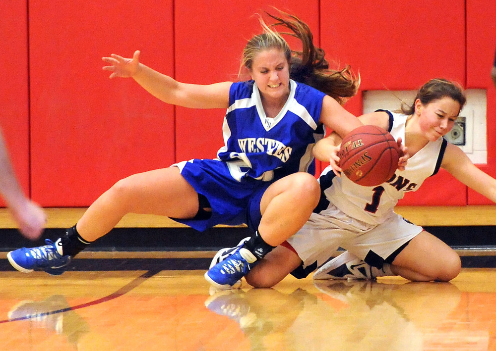 West Haven at Foran in Milford girls basketball, Foran won 34-33. West Haven's Ava Gambardella and Foran's Rebekah DeRosa. Mara Lavitt/New Haven Register<br /> <br /> 1/2/13