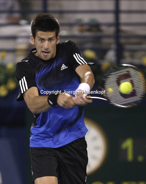 The Barclays Dubai Tennis Championships, ATP Tennis..Turnier, United Arab Emirates,V.A.E...Novak Djokovic (SRB)...Foto: Juergen Hasenkopf..B a n k v e r b.  S S P K  M u e n ch e n, ..BLZ. 70150000, Kto. 10-210359,..+++ Veroeffentlichung nur gegen Honorar nach MFM,..Namensnennung und Belegexemplar. Inhaltsveraendernde Manipulation des Fotos nur nach ausdruecklicher Genehmigung durch den Fotografen...Persoenlichkeitsrechte oder Model Release Vertraege der abgebildeten Personen sind nicht vorhanden.