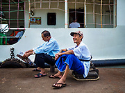 20 NOVEMBER 2017 - YANGON, MYANMAR: Passengers wait to board a Dala bound ferry in Yangon. Tens of thousands of commuters ride the ferry every day. It brings workers into Yangon from Dala, a working class community across the river from Yangon. A bridge is being built across the river, downstream from the ferry to make it easier for commuters to get into the city.     PHOTO BY JACK KURTZ