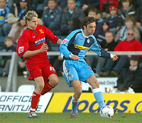 Photo: Leigh Quinnell.<br /> Wycombe Wanderers v Shrewsbury Town. Coca Cola League 2. 11/03/2006. Wycombes Clint Easton is tackled by Shrewsburys David Edwards.