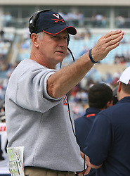 Virginia head coach Al Groh salutes UVA fans who made the road trip to UNC.  The North Carolina Tar Heels defeated the Virginia Cavaliers 7-5 on October 22, 2005 in Chapel Hill, NC.