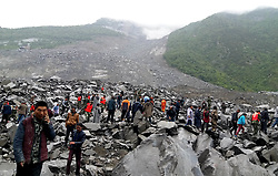 June 24, 2017 - Maoxian, China -  Rescuers working at the accident site after a landslide occurred in Xinmo Village of Maoxian County, Tibetan and Qiang Autonomous Prefecture of Aba, southwest China's Sichuan Province. The landslide on Saturday morning smashed some 40 homes, where about 120 people are feared to be buried. (Credit Image: © Zheng Lei/Xinhua via ZUMA Wire)