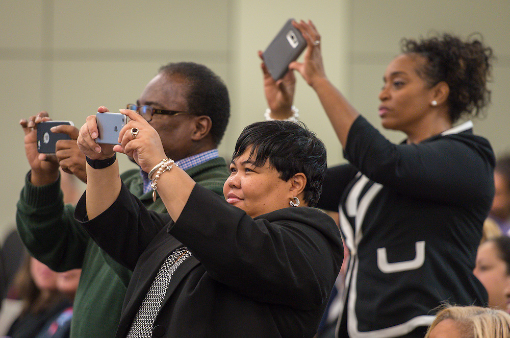 Spectators capture photographs during swearing in ceremonies for newly elected Houston ISD trustees, January 14, 2016.