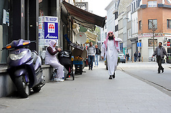 "Fouad Belkacem, a.k.a. Abu Imran, an Islamic extremist who is spearheading the movement ""Sharia4Belgium"", walks through the Borgerhout neighborhood of Antwerp, Belgium on Tuesday, April 3, 2012. (Photo © Jock Fistick)"