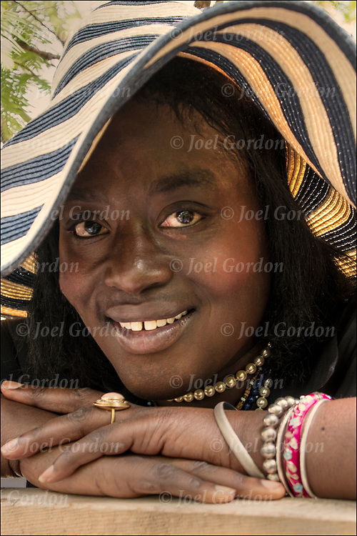 Portrait of Ama smiling African American Krishna woman devotee at the Hare Krishna Festival of Chariot, in Washington Square Park in NYC.<br /> <br /> This brand of Hinduism the movement revere their God, Krishna.