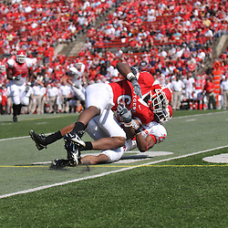Apr 18, 2009; Piscataway, NJ, USA; Rutgers WR Mohamed Sanu (6) is dragged down by DB Brandon Bing (23) during the second half of Rutgers' Scarlet and White spring football scrimmage.