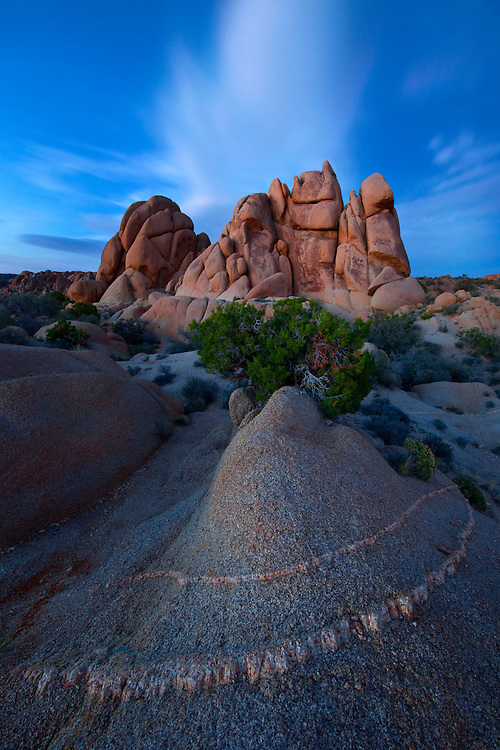 The last glow of twilight over a stack of desert boulders, Joshua Tree National Park, USA.