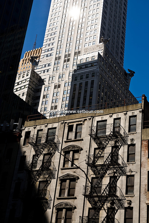 New York. Chrysler Building art deco in midtown and old browstones buildings with outside staircases  New York, Manhattan - United states / le Chrysler Building dans midtown et batiments anciens   Manhattan, New York - Etats-unis