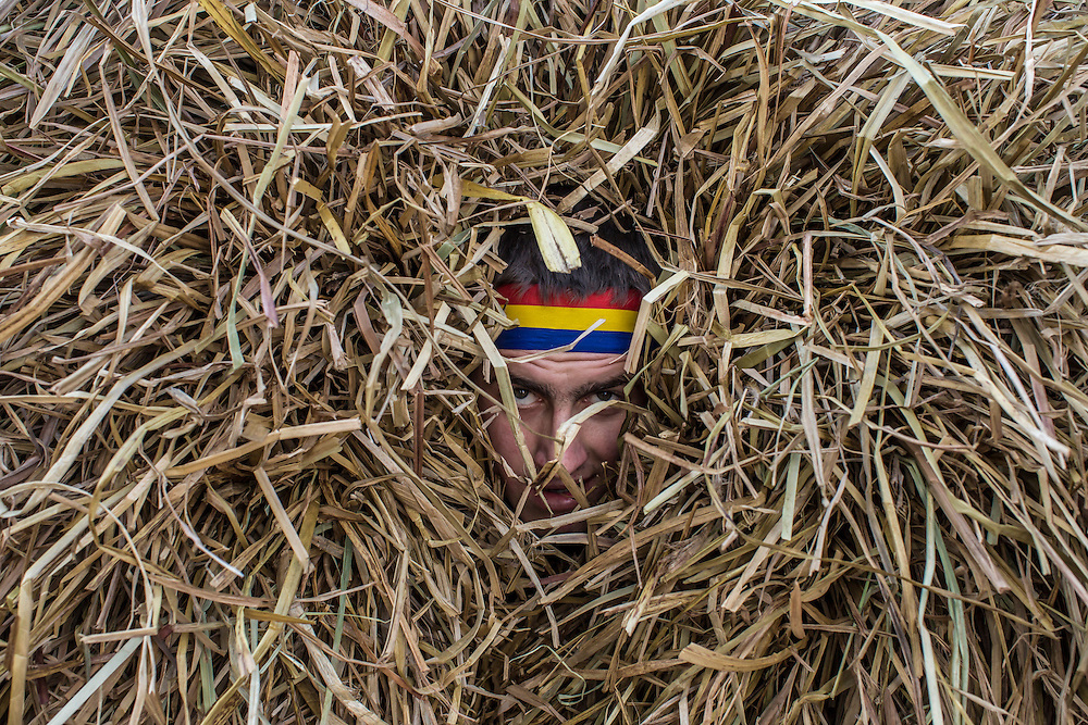 KRASNOILSK, UKRAINE - JANUARY 14: A man inside a hay bale costume celebrates the winter festival of Malanka on January 14, 2015 in Krasnoilsk, Ukraine. The holiday, which involves dressing in elaborate costumes and going from house to house as a group singing traditional songs, is celebrated on New Year's Day of the Orthodox calendar, a week after Orthodox Christmas.