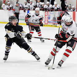 GEORGETOWN, ON  - APR 22,  2017: Ontario Junior Hockey League, Championship Series.  Georgetown Raiders vs the Trenton Golden Hawks in Game 5 of the Buckland Cup Final.  Chays Ruddy #4 of the Trenton Golden Hawks gets called for the hook on Jack Hughes #16 of the Georgetown Raiders during the first period.<br /> (Photo by Shawn Muir / OJHL Images)