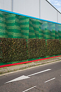The wrap-around construction hoarding of the Tideway Sewer Tunnel dominates a surrounding Bermondsey street, on 16th January 2020, in London, England.