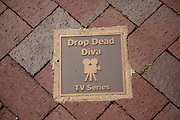 Drop Dead Diva television plaque on the Walk of Fame May 8, 2013 in Senoia, Georgia. Senoia is considered the Hollywood of the South where 24 movies and shows have been filmed.