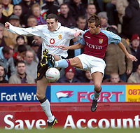 Photo. Matthew Lewis.<br /> Aston Villa v Manchester United. FA Cup 3rd Rd. 04/01/2004.<br /> <br /> Manchester's John O'Shea and Aston Villa's Lee Hendrie compete for the ball.