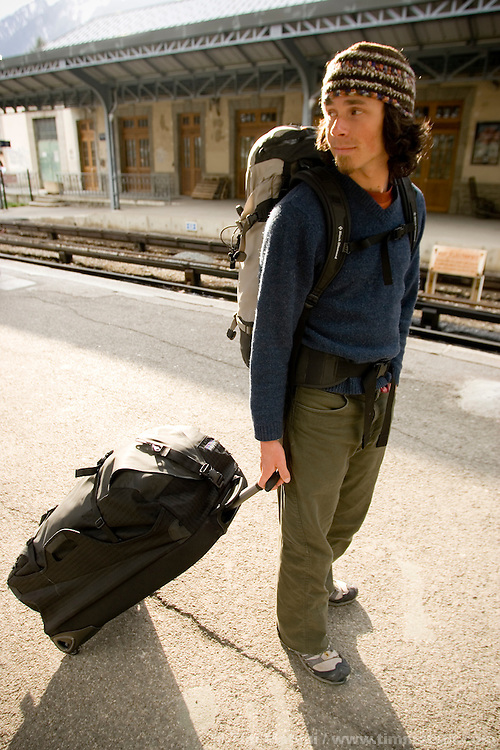 A young caucasian man travels in Chamonix, France.