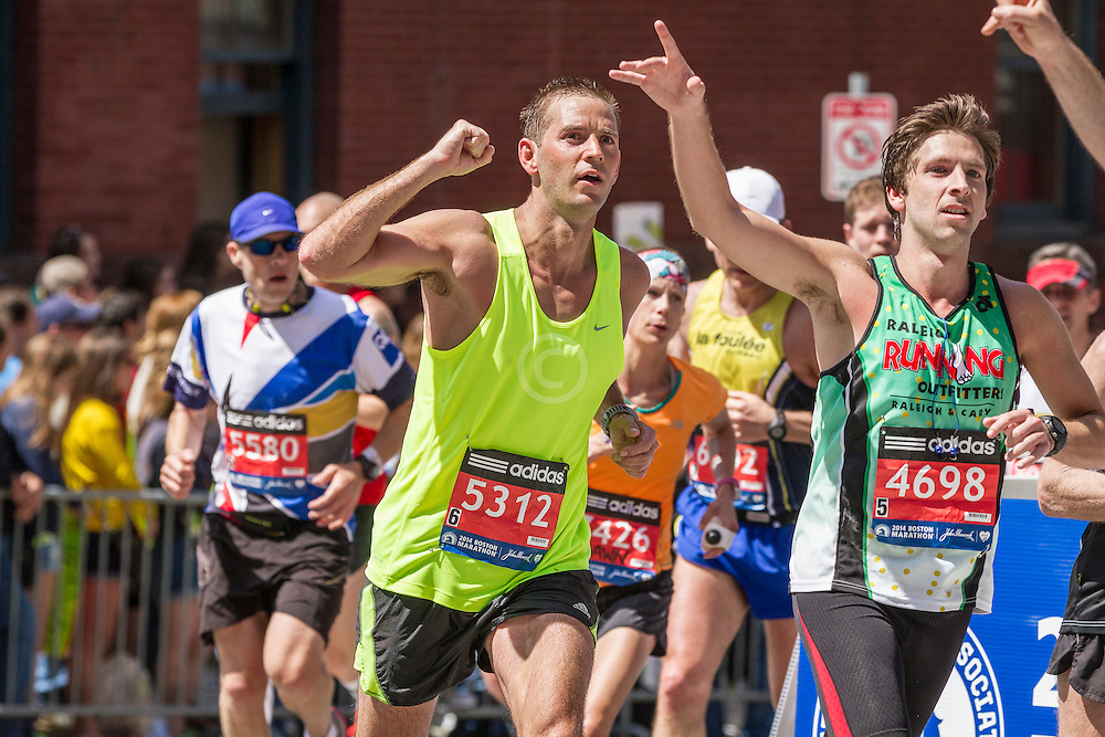2014 Boston Marathon: elated runners heading for the finish line