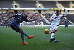 Charlton Athletic's Josh Magennis and MK Dons Josh Tyman