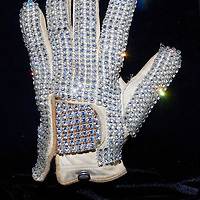 MACAU - FEBRUARY 01:  The famous white rhinestone glove worn by Michael Jackson at the 1983 Motown 25 Television Special during which he premiered the moonwalk to the world, is displayed during the opening ceremony of the MJ Gallery at Ponte 16 Resort-Macau on February 1, 2010 in Macau.  Photo by Victor Fraile / studioEAST