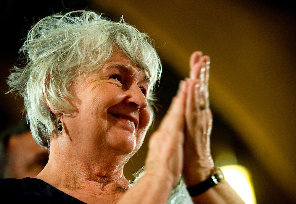042309     Brian Leddy.Joan Wall, mother of Bishop James Wall, applauds after the laying on of hands during his ordination ceremony at Sacred Heart Cathedral on Thursday. Wall was appointed by Pope Benedict XVI to head the diocese.