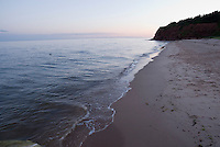 The sky turns blue and pink at sunset at Basin Head beach, Prince Edward Island, Canada.