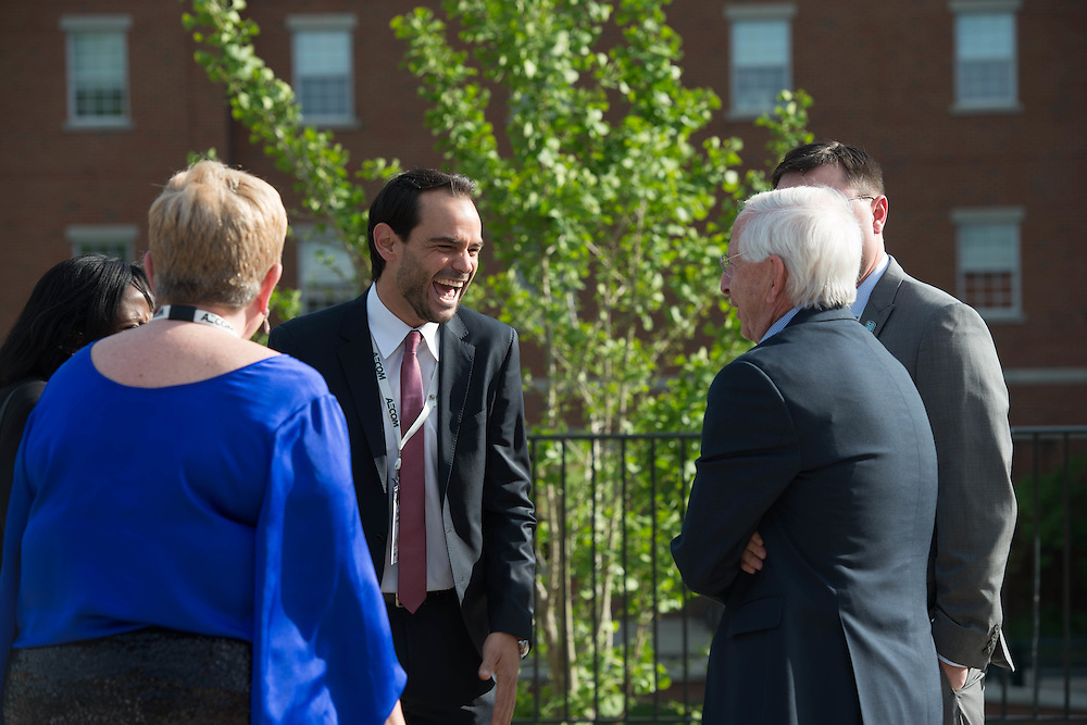Felix Toralba, a sport adminstration student, laughs with Andy Dolich at the Charles R. Higgins Distinguished Alumnus Award Banquet outside of Nelson Commons. © Ohio University/ Photo by Kaitlin Owens