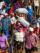 20 NOVEMBER 2017 - YANGON, MYANMAR: Passengers walk down to the Dala Ferry from the Yangon terminal. Tens of thousands of commuters ride the ferry every day. It brings workers into Yangon from Dala, a working class community across the river from Yangon. A bridge is being built across the river, downstream from the ferry to make it easier for commuters to get into the city.     PHOTO BY JACK KURTZ