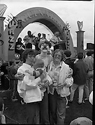 "Guinness Family Day At The Iveagh Gardens. (R83)..1988..02.07.1988..07.02.1988..2nd  July 1988..The family fun day for Guinness employees and their families took place at the Iveagh Gardens today. Top at the bill at the event were ""The Dubliners"" who treated the crowd to a performance of all their hits. Ireland's penalty hero from Euro 88, Packie Bonner, was on hand to sign autographs for the fans...Image shows the crowd enjoying the show being put on by the Dubliners at the Family Day out though the noise seems too much for this little one."