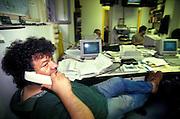 Chawki Senouci, journaist, at work in the newsroom of Radio Popolare (Popular Radio) at Stradella street, in Milan, 1992. Radio Popolare is an Italian free and indipendent radio station; its programs are broadcasted on FM and streaming and by satellite. &copy; Carlo Cerchioli<br /> <br /> Chawki Senouci, giornalista, al lavoro nella redazione di Radio Popolare in via Stradella, Milano, 1992. Radio Popolare, &egrave; una radio di informazione libera e indipendente; i suoi programmi sono trasmessi in FM e streaming e via satellite.