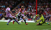 Lasse Vibe (Brentford striker) trying to get Brentford back into the  game during the Sky Bet Championship match between Brentford and Reading at Griffin Park, London, England on 29 August 2015. Photo by Matthew Redman.