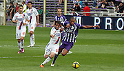 Fabian Delgado and Etienne Capoue fight for the ball.  Toulouse v Lyon (2-0), Ligue 1, Stade Municipal, Toulouse, France, 1st May 2011.
