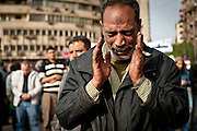 An Egyptian protester named Khalil Ashraf, 48, who attended today's protests with his two sons, weeps as he prays in Tahrir Square, Cairo, the site of major anti-government protests this week.