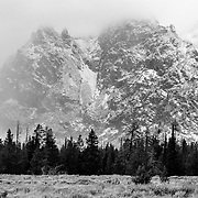 The spires of the Teton Range in Grand Teton National Park are hidden in clouds during an early season September snow storm.