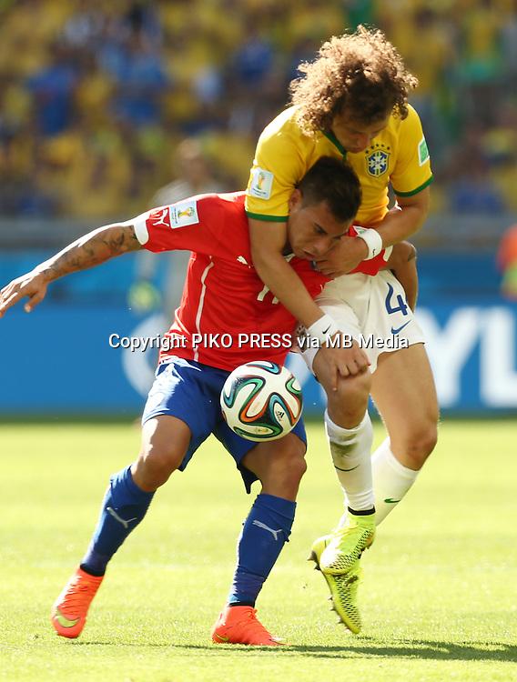 Fifa Soccer World Cup - Brazil 2014 - <br /> BRAZIL (BRA) Vs. CHILE  (CHI) - Round of 16 - Estadio Mineirao Belo Horizonte - Brazil (BRA) - 28 Jun 2014 <br /> Here Chile player Eduardo VARGAS and Brazilian player David Luiz<br /> &copy; PikoPress