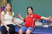 30 DECEMBER 2009 -- PHOENIX, AZ: Crystal Guidice (CQ) a Physical Therapist, works with Mackenzie Saunders during Physical Therapy at St. Joseph's Hospital in Phoenix Wednesday. Mackenzie was knocked down by another player during a soccer game. She finished the game but later in the day her legs started hurting and her parents took her to a hospital. Three hospitals later, she was in St. Joseph's with a diagnosis of a swollen spine and she couldn't walk. Now she's in physical therapy. She is expected to make a full recovery but her doctors have said she won't be able to play soccer for at least another 16 months.   Photo by Jack Kurtz