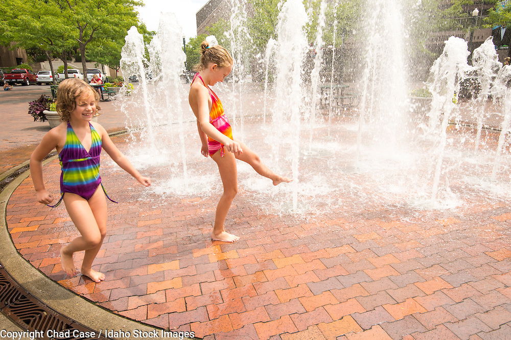 Girls playing at fountains in downtown Boise. Model release.