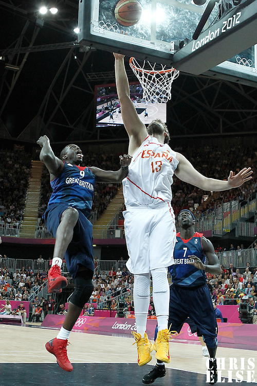 02 August 2012: Spain Marc Gasol reaches for the rebound during 79-78 Team Spain victory over Team Great Britain, during the men's basketball preliminary, at the Basketball Arena, in London, Great Britain.