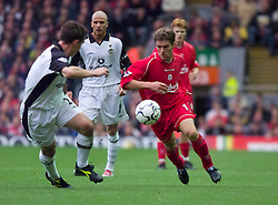 LIVERPOOL, ENGLAND - Sunday, November 4, 2001: Liverpool's Michael Owen takes on Manchester United's Gary Neville during the Premiership match at Anfield. (Pic by David Rawcliffe/Propaganda)