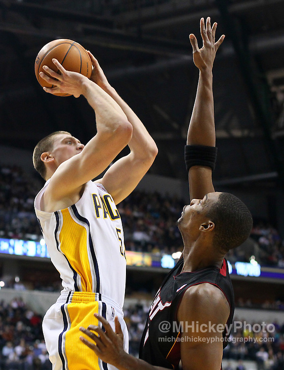 Feb. 15, 2011; Indianapolis, IN, USA; Indiana Pacers forward Tyler Hansbrough (50) shoots over Miami Heat power forward Chris Bosh (1) at Conseco Fieldhouse. Miami defeated Indiana 110-103. Mandatory credit: Michael Hickey-US PRESSWIRE
