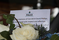 © Licensed to London News Pictures . 02/11/2015 . Liverpool , UK . Tribute in the hearse . The funeral of Police Constable Dave Phillips , at Liverpool Cathedral . Five people are charged in connection with his death , including Clayton Williams , 18 , from Wallasey , who is charged with murder . Photo credit: Joel Goodman/LNP