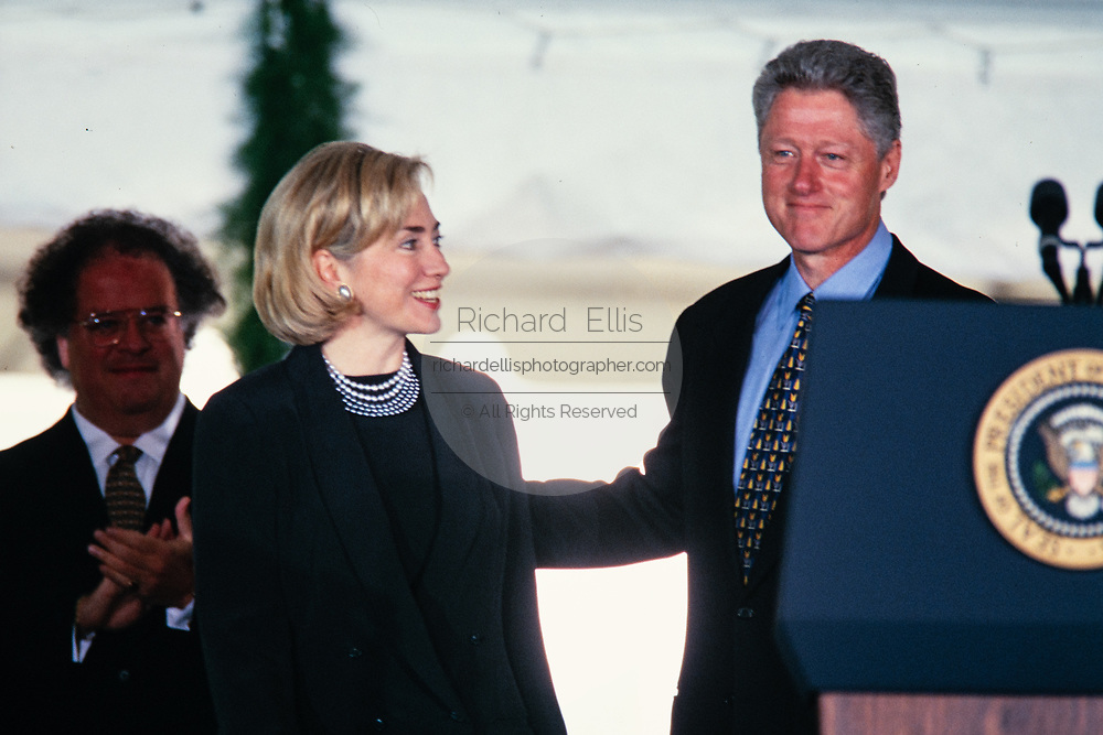 U.S. President Bill Clinton and First Lady Hillary Clinton present the National Medal of Arts during a ceremony on the South Lawn of the White House September 29, 1997 in Washington, DC.