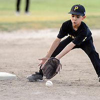 070114  Adron Gardner/Independent<br /> <br />  Pirate Jesse Baca (1) attampts to scoop up a Red Sox ground ball during the Roberto Clemente championship game at Father Dunston Park in Gallup Tuesday.