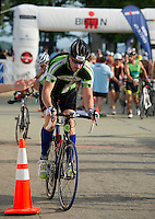 Dave Crowell of Laconia begins the 55 mile bike ride for the Ironman 70.3 Timberman on Sunday morning.  (Karen Bobotas/for the Laconia Daily Sun)