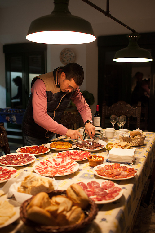 Sergio Venegas prepares charcuteria, at Finca Al Cornocal, Extramadura (Barajoz Province), Spain.