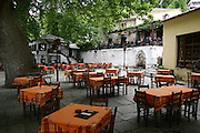 Greece, Thessaly, Makrinitsa on the slopes of mount Pelion empty courtyard of a restaurant in the village centre