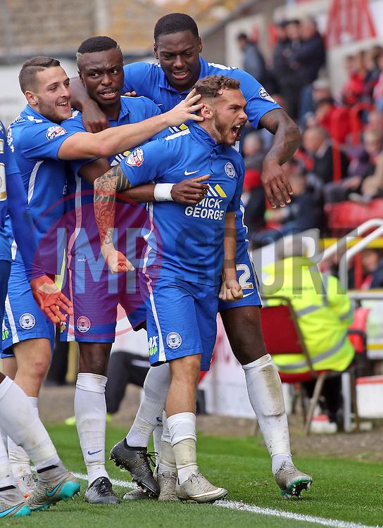 Jon Taylor of Peterborough United (front) celebrates scoring the opening goal - Mandatory byline: Joe Dent/JMP - 07966 386802 - 10/10/2015 - FOOTBALL - County Ground - Swindon, England - Swindon Town v Peterborough United - Sky Bet League One