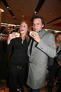 OLIVIA INGE AND CHARLIE GILKES, Uniqlo - Japanese store launch party, 311 Oxford Street, London, W1. 6 November 2007. -DO NOT ARCHIVE-© Copyright Photograph by Dafydd Jones. 248 Clapham Rd. London SW9 0PZ. Tel 0207 820 0771. www.dafjones.com.